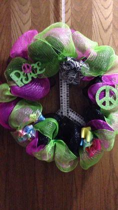 """""""Peace"""" wreath for my 12 yr old... She's all about the peace sign so I attempted to make the wreath into one... Next time I would sew the ribbon in the middle...but I just started using my sewing machine :)"""