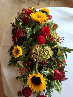Sunflowers, Autumnal Wedding Arrangement | Perfect for an autumn wedding using a combination of ruby reds, green, natural tones and yellow sunflowers | Triangle Nursery Ltd Wholesale Flowers & Accessories for Everyone! For more information on the flowers, visit www.trianglenursery.co.uk