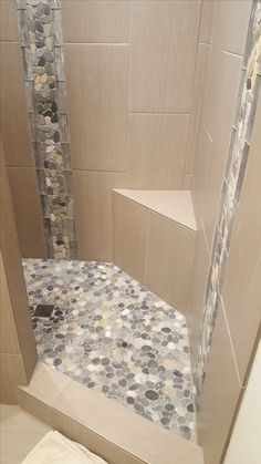 Using Tile in the Bathroom   bathroom   Pinterest   River rock floor     View 2 of the stunning shower remodel using Sliced Bali Ocean Pebble Tile  flooring and the