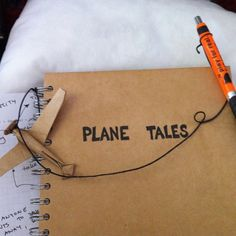 I got on the plane with an empty  notebook with a pen attached to it. I passed it around the ...