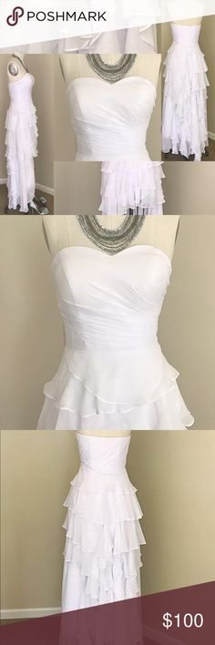"""Custom White Ruffled High-Low Wedding/Formal Gown New, never worn, custom made poly-chiffon, bright-white wedding or formal gown. Lined, boned strapless bodice with pleated detail and built-in bra. 32-34"""" Bust, 25-26"""" Waist. High-Low Skirt is mini length in front and full length in back--covered in beautiful ruffles and ready to show off a great pair of heels. No pictured accessories are included. Dresses High Low"""