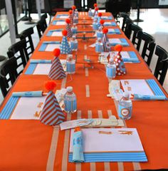 orange and blue airplane themed second birthday party main table with ...