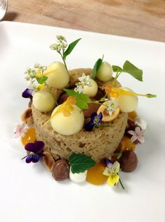 Hazelnut Microwave Sponge Cake, Chocolate Mousse, Passion Fruit Foam, Mango Gel, Toasted Hazelnut with Chefs Garden best Flowers and Herbs in the world!!