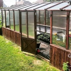 We so want one of these in our backyard! Harden Greenhouse Out of Reclaimed Wood.