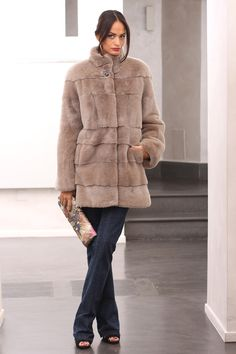 Female Mink Fur coat with whole skins. Made in Italy. Skins Quality: KOPENHAGEN FUR PLATINUM; Color: Beige; Closure: With hooks; Collar: Round; Lining: 100% Satin; Lining Color: Monocolor; Length: 80 cm;