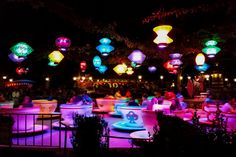 Ride the teacups at night: The colorful lanterns light up the ride and make the sky glow. Eat a massive tur...