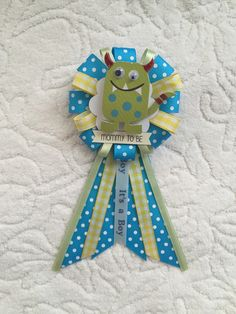 A personal favorite from my Etsy shop https://www.etsy.com/listing/292374149/mommy-to-be-ribbon-corsage-for-baby