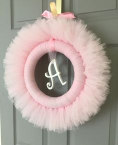 Please welcome Little Miss Tutu Shops newest addition! You select the colors! They make the perfect baby shower or birthday party decoration, and look beautiful hanging from the nursery door or Tulle tutu pom poms Wand Party Decorationfairy by Baby Shower Parties, Baby Shower Themes, Baby Shower Decorations, Baby Shower Wreaths, Tutu Wreath, Diy Wreath, Tulle Crafts, Diy And Crafts, Baby Kranz