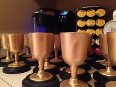 DIY Trophies! Dollar Tree Cups, spray paint, wooden circles or squares and crazy glue! Make em for any occasion... :)