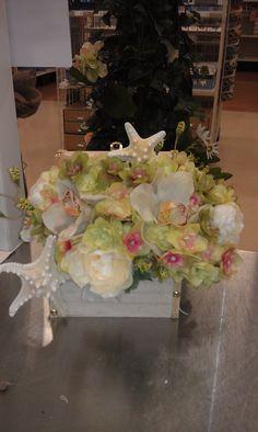 Beach wedding treasure chest flower arrangement