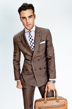 Looking sharp in a brown suit.