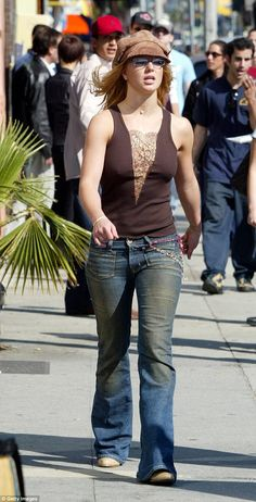 The original! Britney Spears rocked a super similar outfit with her hat and plunging top in 2003