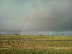 This is a picture of a beautiful rainbow seen between Leeuwarden and Harlingen in the province Friesland in the country of The Netherlands. Because Friesland is next to the Waddensea and the Northsea, it can be very windy here - by Mirjam van der Sloot