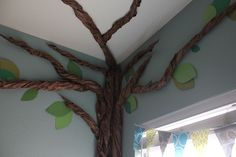 Paper tree :)   Could maybe do this in book corner and add some fabric.