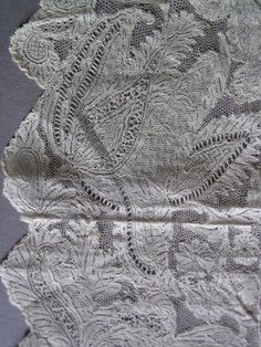 An edging of early 18th Century flat mesh grounded needlelace,