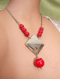 Modernist Necklace by BENGEL  +++  Shiny red galalith balls with intricate chain and ribbed central chrome diamond by Bengel. Central diamond shaped section measures 2.25 inches high (5.5cm). It measures 16 inches (41cm) from clasp to clasp