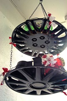 No permalink :(  But, recycled hubcap shelves (far down the page).  I was thinking these would a nice outdoor tiered plantholder, too.  Might be cool in a boy's car-themed bedroom?