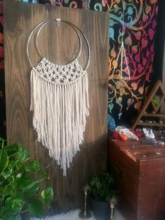 Olivia  Olivia combines my two favorite things, dream catchers and macrame. This earthy babe uses 100% cotton rope, a size 14 inch hoop and a 10 inch hoop. It measures approximately 40 inches from top to bottom. Hang it in your boho styled home or a sweet nursery.  **MADE TO ORDER**  Have you seen my other Macrame wall hangings? Check this one out before you leave:  https://www.etsy.com/listing/513275769/macrame-wall-hanging-modern-macrame