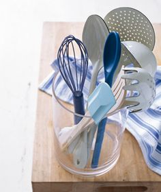 Vase as Utensil Holder - Tidy countertops by gathering kitchen tools like spatulas and spoons in a widemouthed vase.