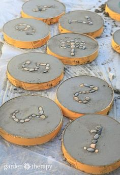 Hopscotch Garden Stepping Stones - - These DIY concrete stepping stones make for a whimsical pathway and a fun weekend project. Set the numbers up for kids to play hopscotch in the garden! Concrete Stepping Stones, Garden Stepping Stones, Rocks Garden, Stones For Garden, Stone Garden Paths, Concrete Projects, Diy Concrete, Concrete Garden, Concrete Planters