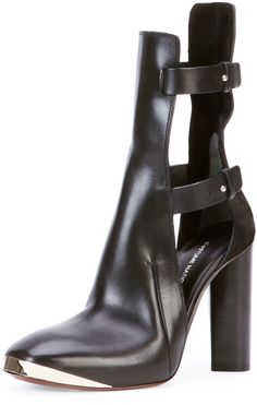 $580, Black Cutout Leather Ankle Boots: CNC Costume National Costume National Cutout Leather Ankle Bootie Black. Sold by Neiman Marcus. Click for more info: https://lookastic.com/women/shop_items/78209/redirect