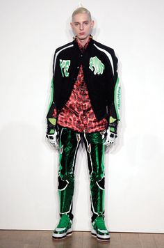 KATIE EARY's AW11 ghoulish take on a varsity jacket with green and white detailing and printed graphics.