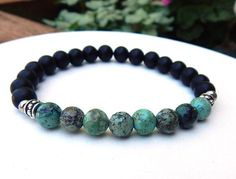 This gemstone mens bracelet is made with 8mm Rustic African Turquoise surrounded by smooth 8mm Matte Black Onyx. Very cool.  African Turquoise