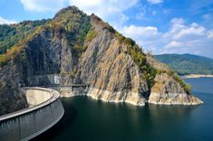 Photo about Vidraru Dam and Lake, Romania (Fagaras mountains in Carpathians). Beautiful Roads, Beautiful Places, Visit Romania, Fairytale Castle, Bucharest, Summer Travel, Rocky Mountains, Great Places, Amazing Places