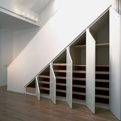Simple version for under stairs storage. This would totally work if we gutted the basement as it is now. wAaaay better storage! (Plus, no more dark crawling under the stairs to get at my christmas decorations!) This is sorta what dad wants to do here.