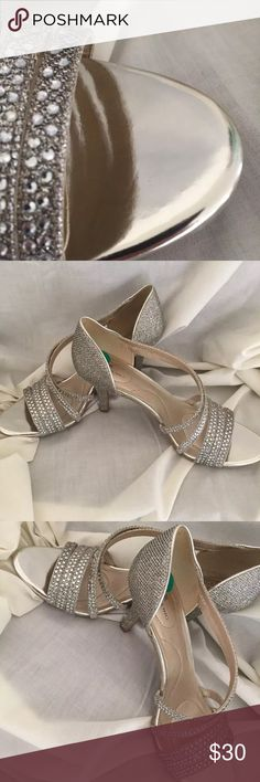 """Bandolino Silver Rhinestones High Heels New Brand new without tag.   Bandolino size 8M high highs  Silver and the straps are covered in rhinestones.  Insole is gold  3"""" heel  Man made lining and sole Bandolino Shoes Heels"""