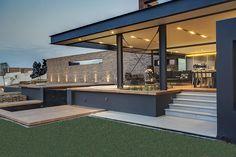 Casa com combinação perfeita de concreto, vidro e aço - limaonagua