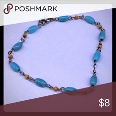 Anklet Pretty Bohemian-style Anklet with Turquoise Colored and Wooded beads on silver links. Perfect for Summer Casual or Beach. Jewelry