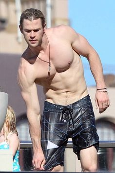 Chris Hemsworth shows off his ripped body as he chills by his hotel pool at the Park Hyatt Sydney. 6-18-2012