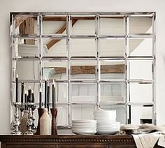 $699. You could make a knock-off with $25 worth of dollar store mirrors and some odds and ends. Fall Preview | Pottery Barn