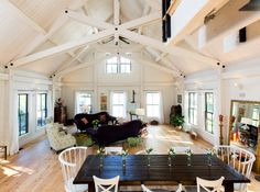 Often the centerpiece of a home, timber frame great rooms can be capacious or cozy. Timber Frame Cabin, Timber House, Timber Frames, New England Homes, New Homes, Wooden Buildings, Modern Style Homes, Living Room Update, House And Home Magazine