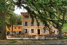 STATS 6 BEDROOMS 5 BATHS 5 HALF BATHS 6,200 SQ. FT. $8.8 MILLIONPedigree: Some 30 minutes by car from the town of Hyères on the Côte d'Azur, this secluded 19th-century farmhouse anchors 111 pristine hillside acres. Exposed wood ceiling beams and stone hearths impart rustic beauty to the refurbished rooms, which invite indoor-outdoor living thanks to a series of French doors that lead to broad terraces. Foodies will be drawn to the sleek kitchen, featuring white tile walls and stainless-ste...