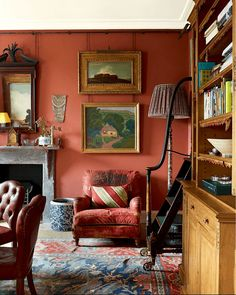Robert Kime's Handsome London Home Bold red walls make a statement in the dining room. His interiors are always wonderfully layered—the rugs, the textiles, the books, the art. English Interior, English Decor, Antique Interior, Casas Magnolia, Block House, Living Room Decor, Living Spaces, Dining Room, Dream Homes