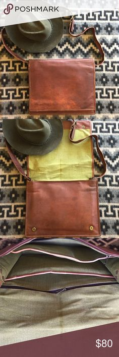 """Large handmade leather full flap messenger bag Handmade Indian goat leather messenger bag. All bags are colored naturally by the sun followed by an oil finish, giving them a rustic vintage look. Great for 13"""" or smaller laptops!  Features a sturdy and durable canvas lining  Dimensions: 15"""" 11""""H 4""""W Strap adjusts from 18.5""""-24""""  *Handmade in Udaipur, Rajasthan, India by a small group of friends Bags Laptop Bags"""