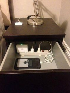 Organization Tip: Put a power strip in the top drawer of your nightstand to charge, organize, and hide your electronics.  Via Marsh Building Products on Facebook.
