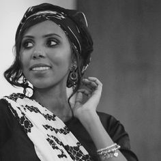 """Whatever they do, I am not afraid. They are not going to make me stop. The safety of our daughters is more important than that."" Jaha Dukureh She's an activist that works hard to #EndFGM. Dukureh experienced FGM, and she won't allow other generations to go through that. @jahaendfgm looks stunning - and fierce - wearing our Let's Make Equality Reality cashmere-silk Shawl. #IWEARCAUSEICARE #Feminist #EqualityNow #SafeFearlessFree"