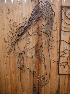 METAL SCULPTURE OF A WOMAN.