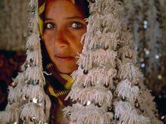beautiful berber woman wearing handira (wedding blanket)