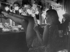 Chorus Girl-Singer Linda Lombard, Resting Her Legs after a Tough Night on Stage Photographic Print by George Silk at Art.com