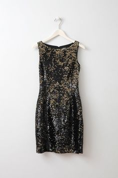 Callie Black and Gold Sequin dress Designed to hug your curves, this flattering bodycon party dress is covered in light-catching sequins. It's fully lined for a smooth and slim fit.