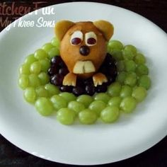 Cute groundhog snack idea w/ red & green grapes & a pear!  How cute!  My child would probably eat the grapes.