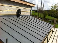 Single ply roofing with standing seam effect.  http://www.flatroofscornwall.com/flat-roofing-services/single-ply-roofing