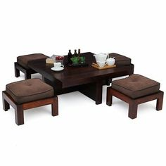 A stylish and practical wooden #coffee #table #set for all the lovers of handcrafted furniture out there. A classic wooden coffee table and four #upholstered #stools in a #darkbrown colored fabric complete this elite set.