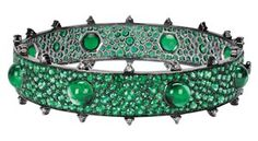 Gemfields' bangle by Nam Cho is made with 23ct of Zambian emeralds in varying sizes of cabochon cuts for a dramatic and very tactile effect.