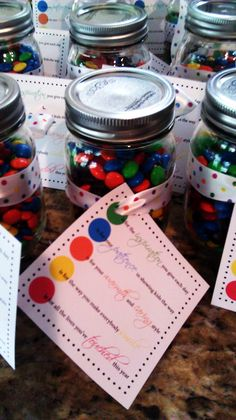 M & M jar filled with inspiring color quotes for your teacher.