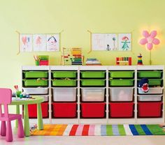 ikea playroom storage - I really need to do this in Sander's room. Looks way nicer than the various items I have tossed around his room to store toys...